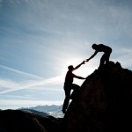 Helping-Eachother-up-Cliff